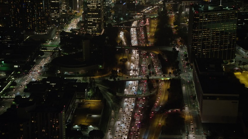 5K aerial video fly over 110 freeway with heavy traffic, Downtown Los Angeles, California, night Aerial Stock Footage | AX64_0403