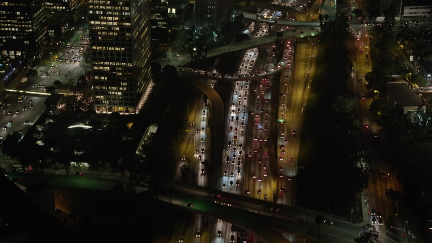 5K stock footage aerial video of heavy traffic on Highway 110, Downtown Los Angeles, California night Aerial Stock Footage | AX64_0404