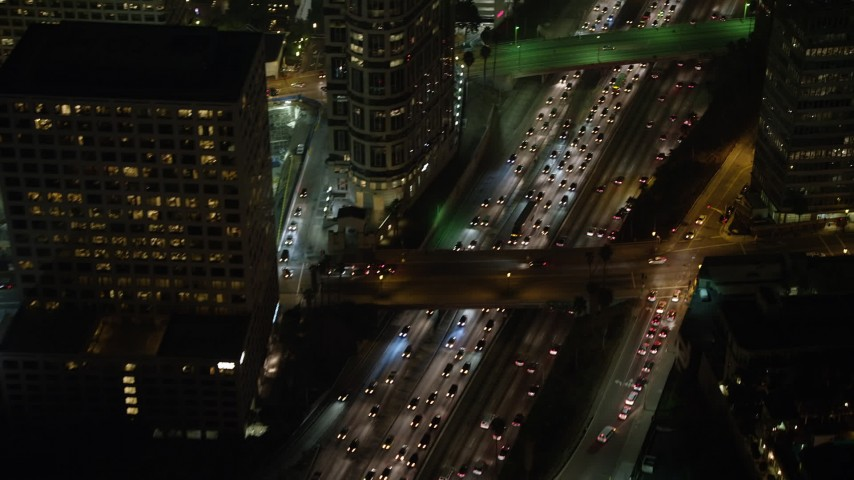 5K stock footage aerial video of bird's eye view of heavy traffic on Highway 110, Downtown Los Angeles, California, night Aerial Stock Footage | AX64_0405