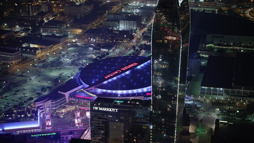 5K aerial video of passing Ritz-Carlton Hotel to focus on Staples Center, Downtown Los Angeles, California, night Aerial Stock Footage | AX64_0406
