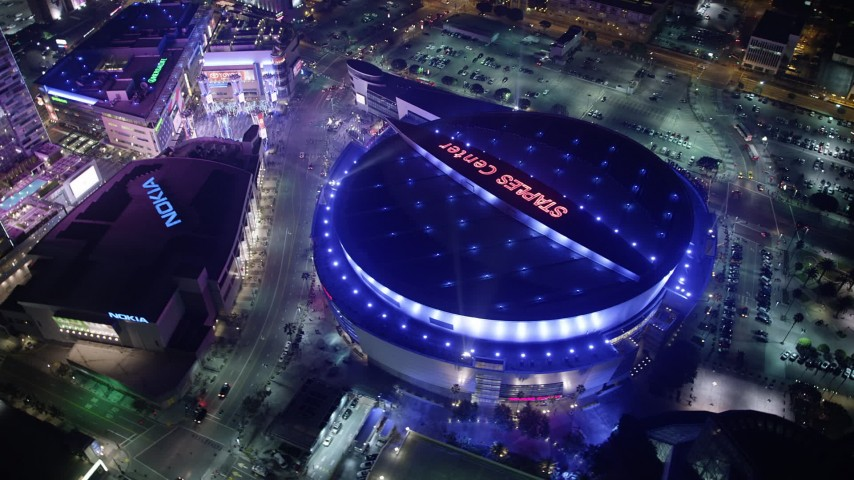 5K stock footage aerial video of Nokia Theater and Staples Center arena in Downtown Los Angeles, California, night Aerial Stock Footage | AX64_0407
