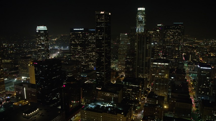 5K aerial video flyby skyscrapers around US Bank Tower at night in Downtown Los Angeles, California, night Aerial Stock Footage | AX64_0410
