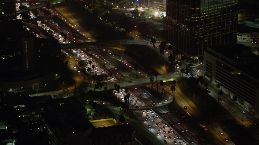 5K stock footage aerial video of heavy traffic on Highway 110 and overpasses, Downtown Los Angeles, California, night Aerial Stock Footage | AX64_0414