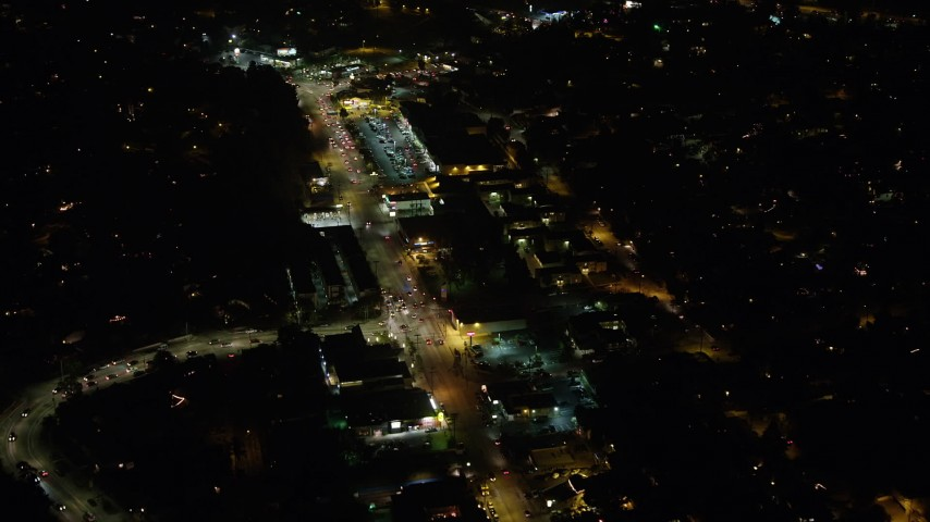 5K stock footage aerial video of strip mall on Glendale Boulevard at night, Silverlake, Los Angeles, California Aerial Stock Footage | AX64_0419