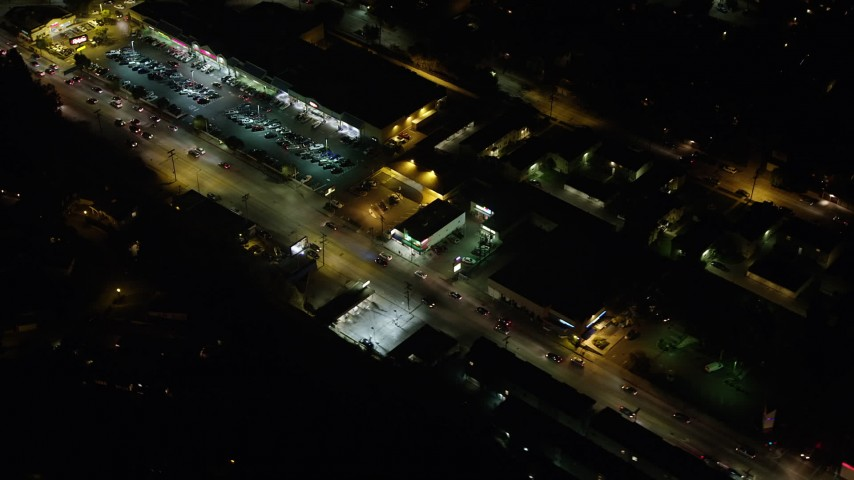 5K stock footage aerial video of a strip mall and light traffic on Glendale Boulevard, Silverlake, Los Angeles, California, night Aerial Stock Footage | AX64_0420