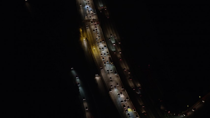 5K stock footage aerial video of a bird's eye view of heavy traffic on Interstate 5, Glendale, California, night Aerial Stock Footage | AX64_0425