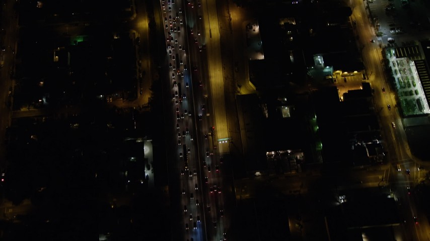5K stock footage aerial video tilt to bird's eye view of heavy traffic on Interstate 5, Burbank, California night Aerial Stock Footage | AX64_0427