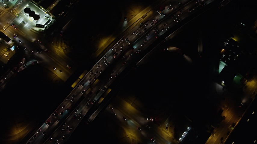 5K stock footage aerial video bird's eye of heavy traffic traveling on Interstate 5, Burbank, California, night Aerial Stock Footage | AX64_0428