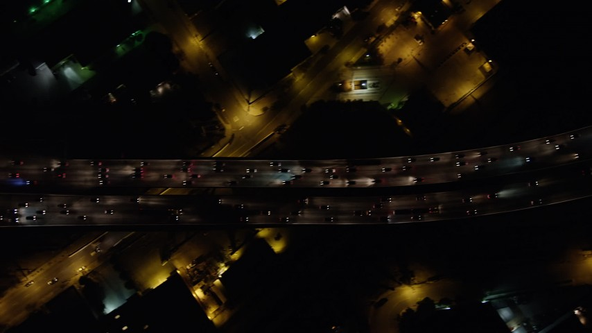 5K stock footage aerial video of bird's eye of I-5 freeway with heavy traffic, Burbank, California, night Aerial Stock Footage | AX64_0429