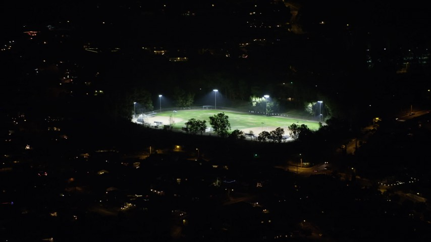 5K stock footage aerial video of a baseball field with lights, Burbank, California, night Aerial Stock Footage | AX64_0433
