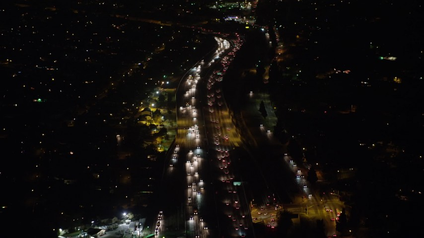 5K stock footage aerial video of following traffic on Interstate 5 freeway, Sun Valley, California, night Aerial Stock Footage | AX64_0434