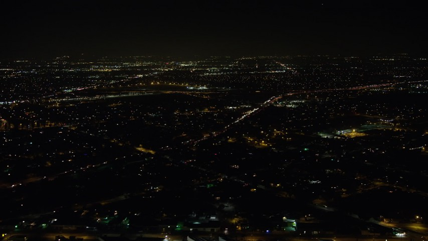 5K stock footage aerial video of Interstate 5 and suburban neighborhoods at night, Sun Valley, California Aerial Stock Footage | AX64_0441
