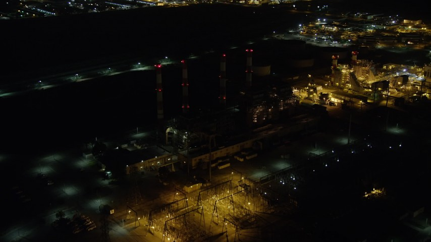 5K stock footage aerial video of passing the LADWP power plant with smoke stacks, Sun Valley, California, night Aerial Stock Footage | AX64_0443