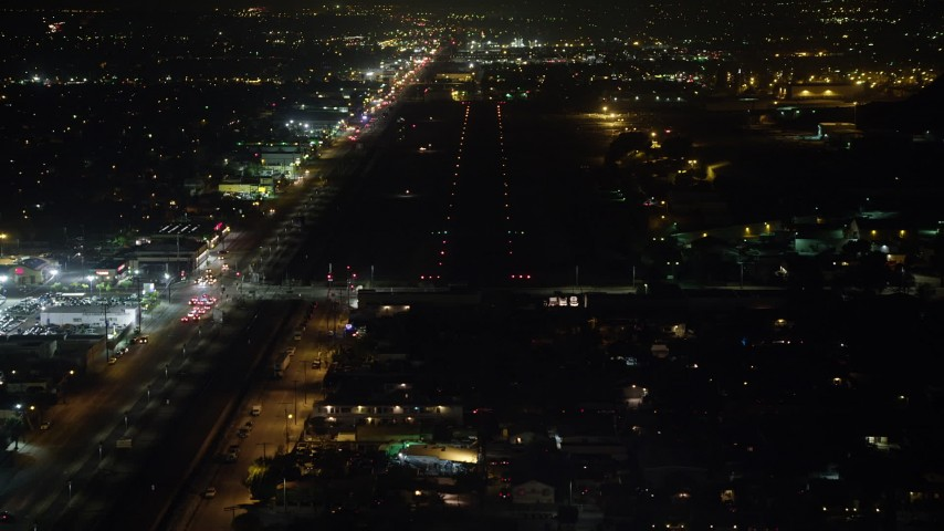 5K stock footage aerial video of approaching a runway at Whiteman Airport, Pacoima, California, night Aerial Stock Footage | AX64_0445