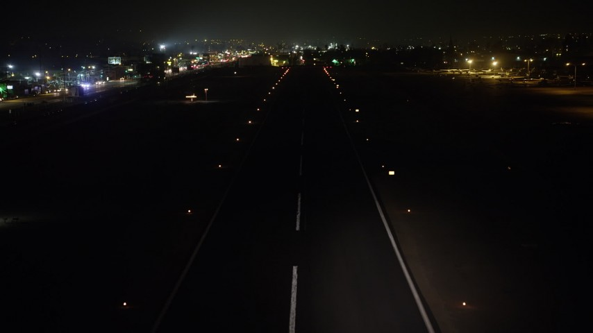 5K stock footage aerial video of landing on the runway at Whiteman Airport, Pacoima, California, night Aerial Stock Footage | AX64_0447