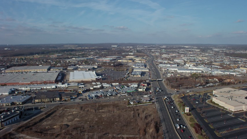5K stock footage aerial video follow Broadhollow Road to approach stores and shopping centers in Farmingdale, Long Island, New York, winter Aerial Stock Footage | AX65_0002