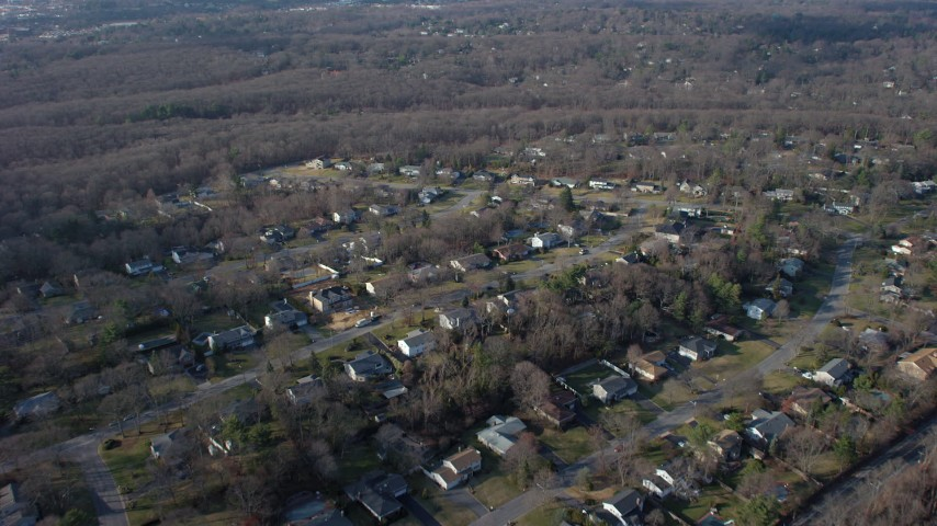 5K stock footage aerial video fly over suburban homes and leafless trees in Plainview, Long Island, New York, winter Aerial Stock Footage | AX65_0007