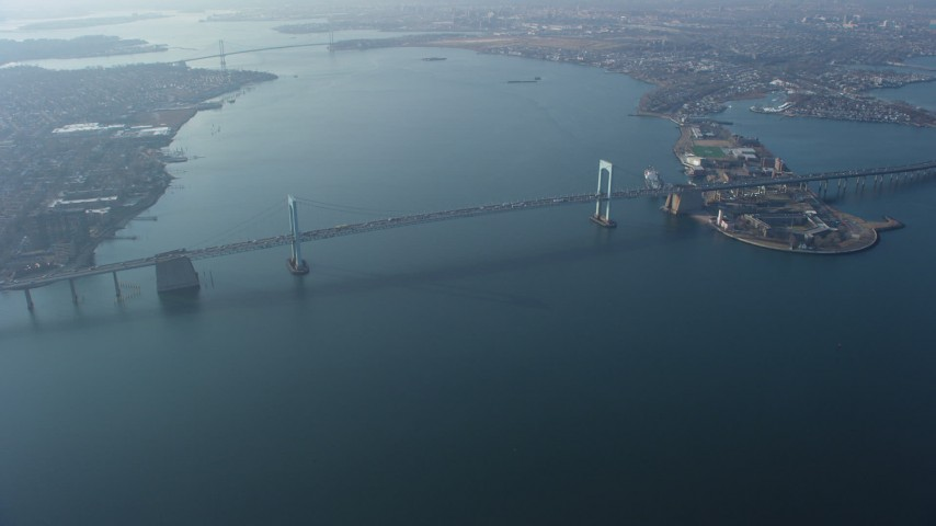 5K stock footage aerial video approach Throgs Neck Bridge spanning the East River, Long Island, New York, winter Aerial Stock Footage | AX65_0029