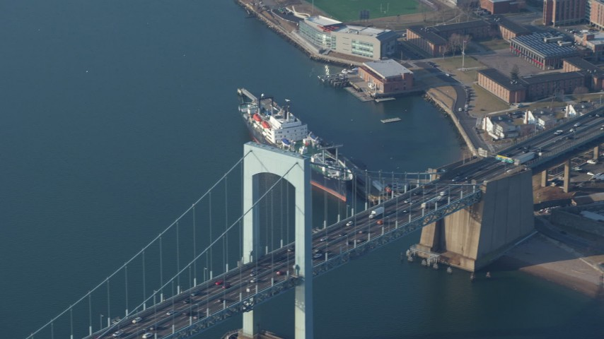5K stock footage aerial video track cars crossing Throgs Neck Bridge spanning the East River, Long Island, New York, winter Aerial Stock Footage | AX65_0030