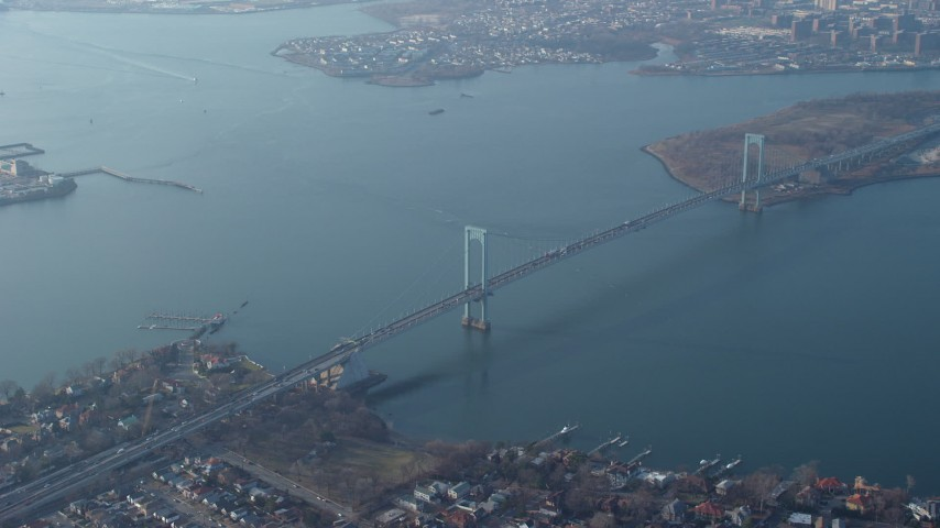 5K stock footage aerial video of Bronx Whitestone Bridge spanning the East River, Long Island, New York, winter Aerial Stock Footage | AX65_0032