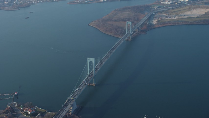 5K stock footage aerial video flyby the Bronx Whitestone Bridge spanning the East River, Long Island, New York, winter Aerial Stock Footage | AX65_0033