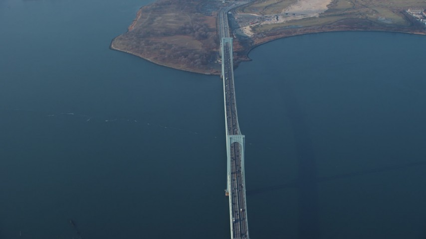 5K stock footage aerial video of passing the Bronx Whitestone Bridge spanning the East River, Long Island, New York, winter Aerial Stock Footage | AX65_0034