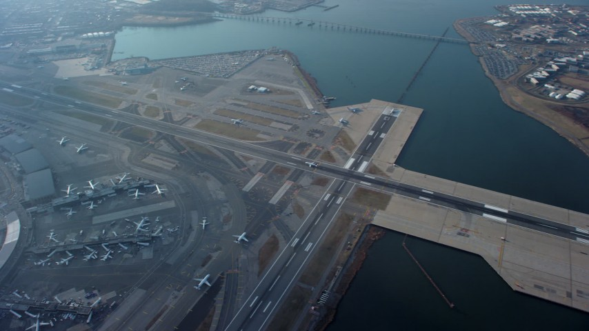 5K stock footage aerial video of a bird's eye view of LaGuardia Airport, Queens, New York City, winter Aerial Stock Footage | AX65_0037