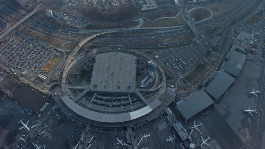 5K stock footage aerial video of a bird's eye of LaGuardia Airport, Queens, New York City, winter Aerial Stock Footage | AX65_0038