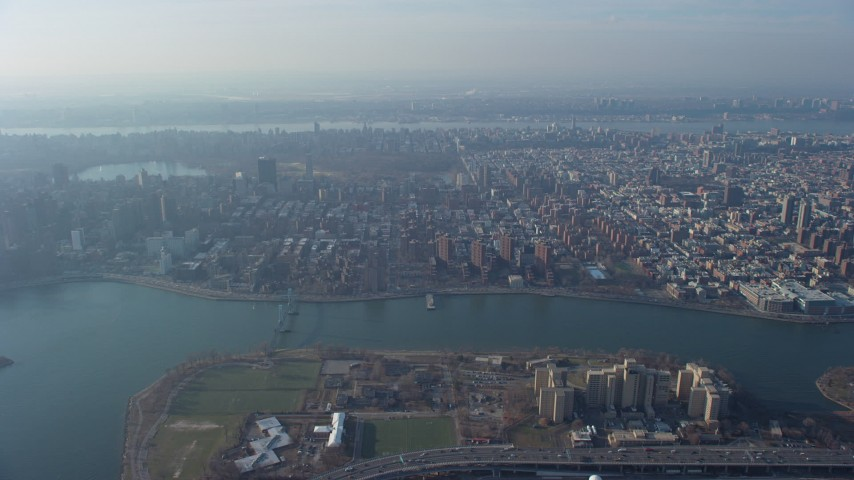 5K stock footage aerial video approach public housing, urban neighborhoods, and Central Park, Upper East Side, Harlem, New York City, winter Aerial Stock Footage | AX65_0042