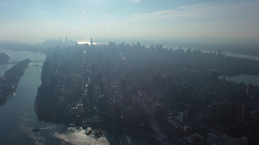 5K stock footage aerial video of a view of Midtown Manhattan seen from the Upper East Side, New York City, winter Aerial Stock Footage | AX65_0043