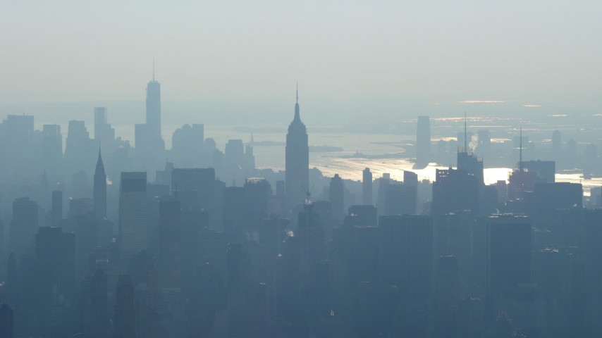 5K stock footage aerial video of Empire State Building and Midtown Manhattan skyscrapers, and Lower Manhattan skyscrapers in the background, New York City, winter Aerial Stock Footage | AX65_0044