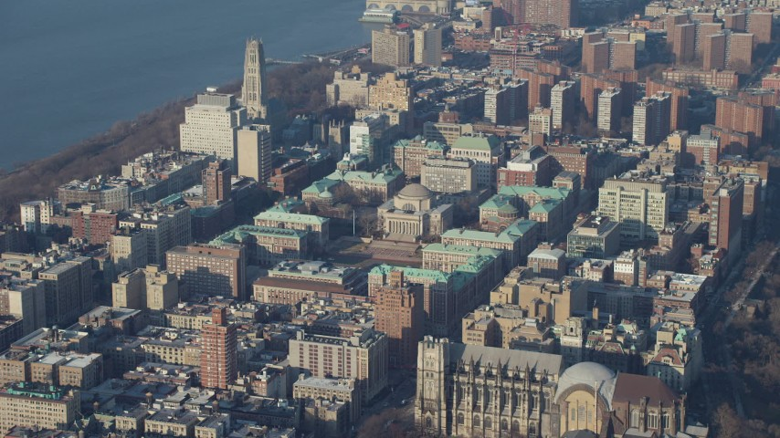 Approach the Columbia University campus in New York City, winter Aerial Stock Footage AX65_0047