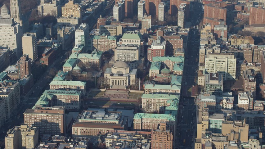 Approach Low Memorial Library on the Columbia University campus in New York City, winter Aerial Stock Footage | AX65_0048