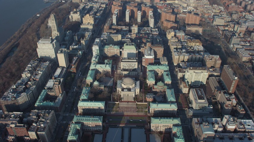 Tilt to a bird's eye view of Low Memorial Library on the Columbia University campus in New York City, winter Aerial Stock Footage AX65_0049 | Axiom Images