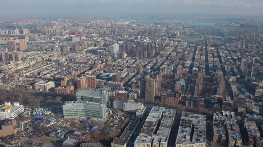 5K stock footage aerial video of urban neighborhoods in Harlem and office buildings in Manhattanville, New York City, winter Aerial Stock Footage AX65_0051 | Axiom Images