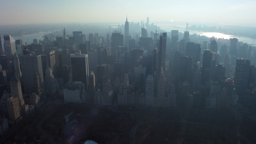 5K stock footage aerial video approach Midtown skyscrapers from Central Park, New York City, winter Aerial Stock Footage | AX65_0058