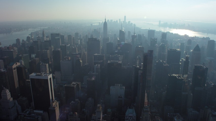 5K stock footage aerial video fly over Midtown skyscrapers to approach the Empire State Building, New York City, winter Aerial Stock Footage | AX65_0059