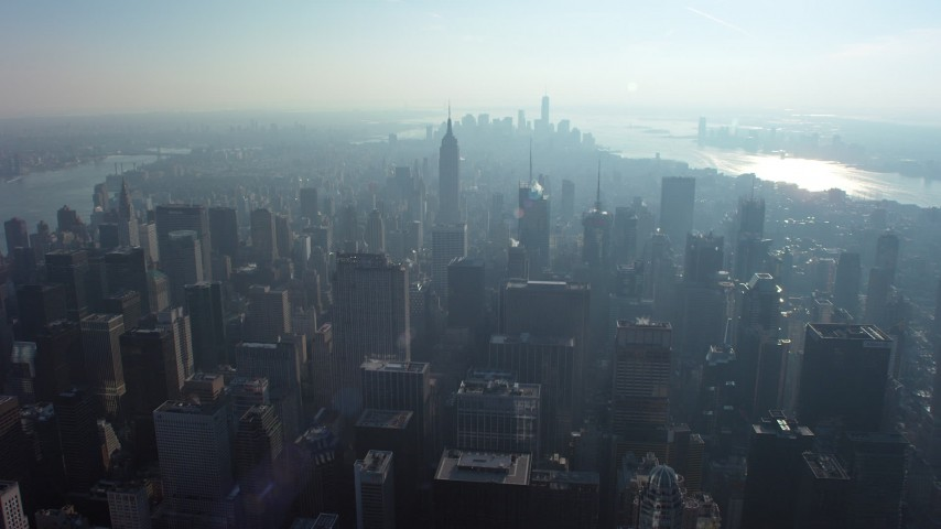 Fly over skyscrapers to approach the Empire State Building, Midtown Manhattan, New York City, winter Aerial Stock Footage | AX65_0060