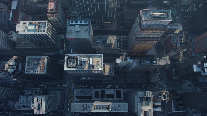 Bird's eye view of city streets and skyscrapers in Midtown Manhattan, New York City, winter Aerial Stock Footage AX65_0061
