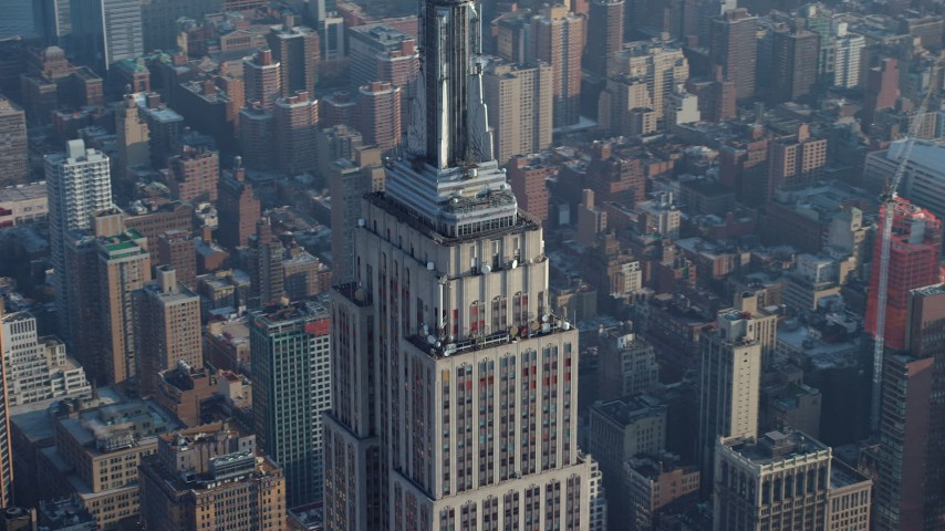 Track the top of the Empire State Building in Midtown Manhattan, New York City, winter Aerial Stock Footage | AX65_0063
