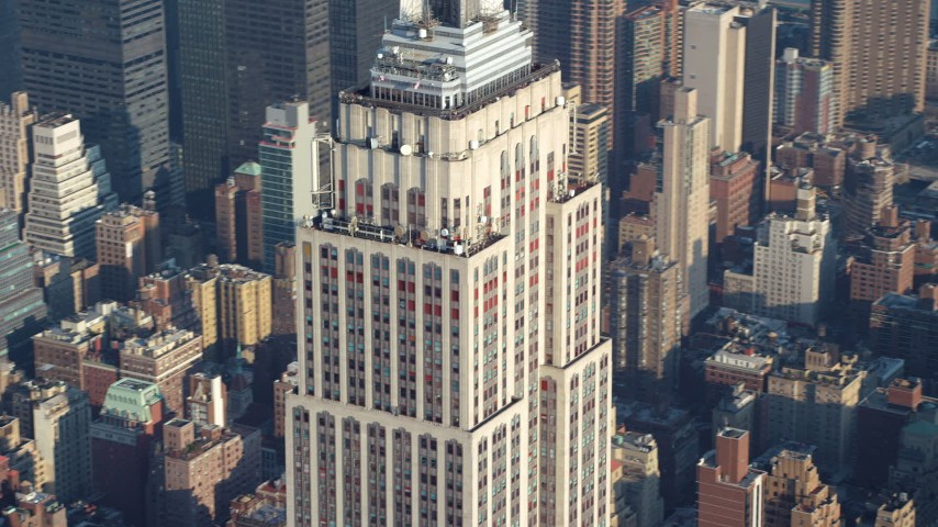 Tilt down the length of the Empire State Building in Midtown Manhattan, New York City, winter Aerial Stock Footage | AX65_0064