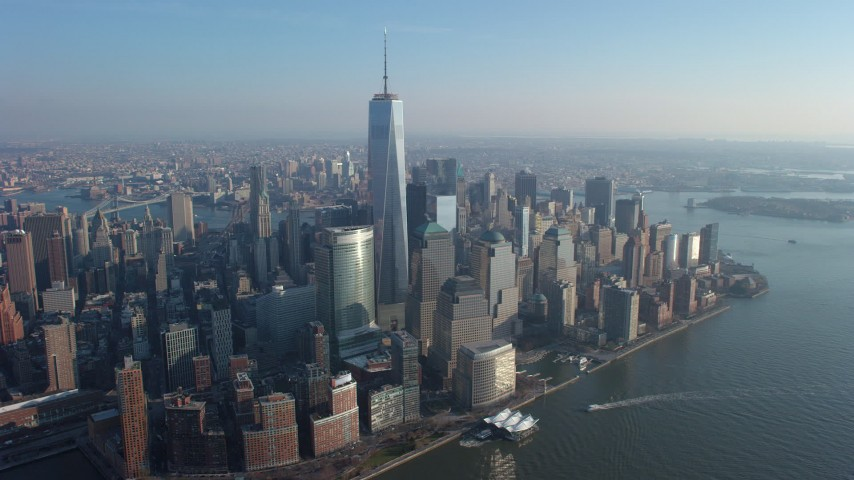 A view of Freedom Tower and World Trade Center skyscrapers, Lower Manhattan, New York City, winter Aerial Stock Footage | AX65_0069
