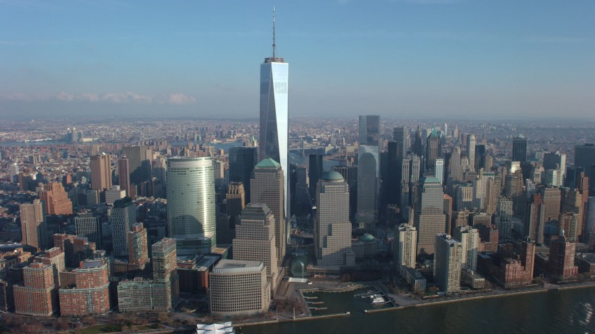 Freedom Tower standing tall by World Trade Center skyscrapers in Lower Manhattan, New York City, winter Aerial Stock Footage | AX65_0071