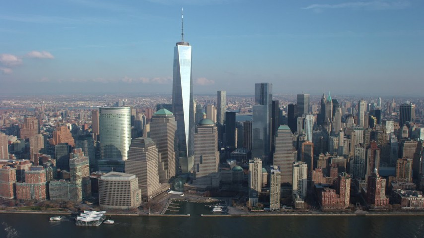 Pass by giant Freedom Tower and World Trade Center skyscrapers in Lower Manhattan, New York City, winter Aerial Stock Footage | AX65_0072