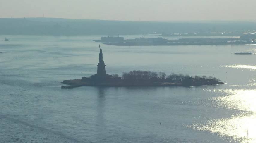Approach the Statue of Liberty, New York, winter Aerial Stock Footage | AX65_0074