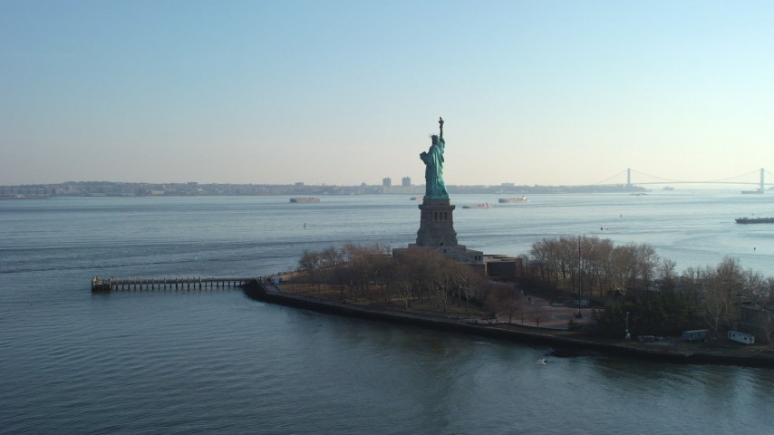 Fly around the back of the Statue of Liberty, New York, winter Aerial Stock Footage | AX65_0077