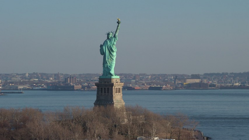 5K stock footage aerial video orbit the torch side of the Statue of Liberty, New York, winter Aerial Stock Footage | AX65_0078