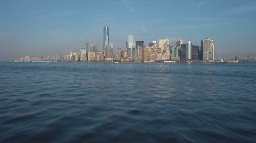 5K stock footage aerial video tilt from New York Harbor to reveal and approach the Lower Manhattan skyline, New York City, winter Aerial Stock Footage | AX65_0084