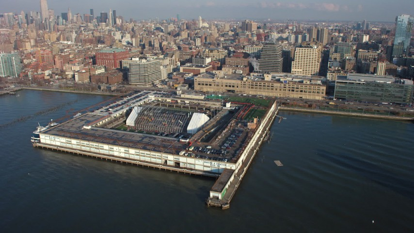 5K stock footage aerial video approach Pier 40 at Hudson River Park in Greenwich Village, New York City, winter Aerial Stock Footage | AX65_0089