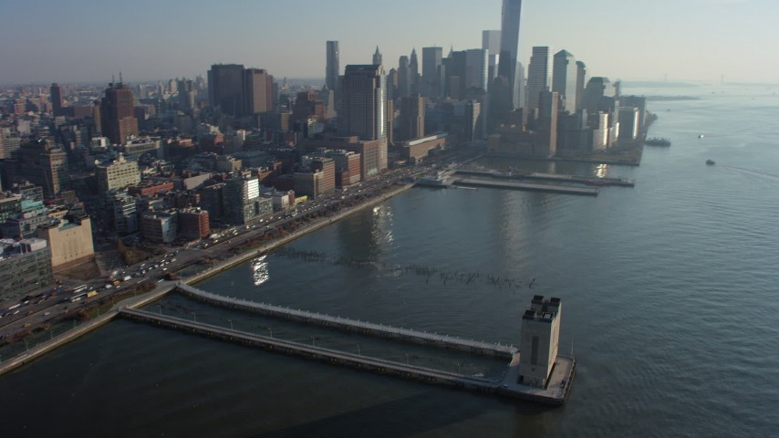 Tilt from Pier 34 to approach World Trade Center skyline in Lower Manhattan, New York City, winter Aerial Stock Footage | AX65_0090